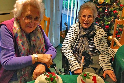 residents with Christmas cakes